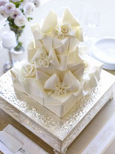 Bows and Flowers #wedding #cake