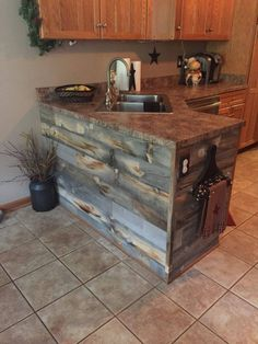 Rustic kitchen island with Stikwood Reclaimed Wood!