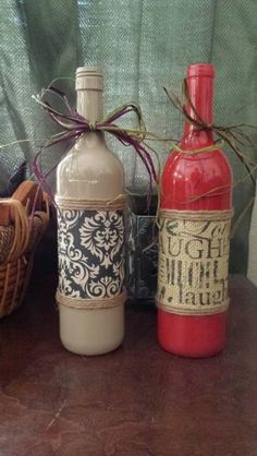 Painted wine bottles for decorating your home! My newest hobby!