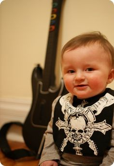 An old t-shirt is a new bib... i love it! I would like to do this with old rock and roll tees like KISS and ACDC