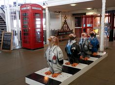 'Beatles' Penguin figures at Woodside Ferry terminal, Birkenhead. This sculpture is based on 'Abbey Road', and a similar sculpture was on display at Liverpool Pier Head in Abbey Road, The Beatles, Penguin, Liverpool, Display, Sculpture, Coat, Fashion, Floor Space