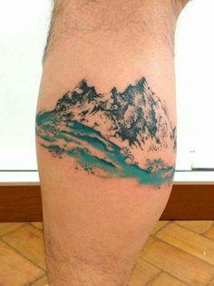 Watercolor mountain sea tattoo