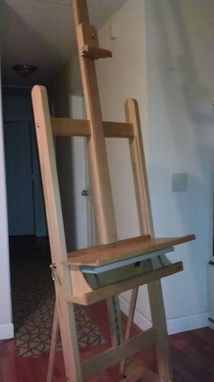 This hardwood easel was made specifically for an apple desktop with an extra long shelf to fit the computer base. The caster wheels allow you to easily roll it anywhere in the house which is extra handy for movie watching or streaming videos. The adjustable shelf allows you to work standing up, sitting on a stool or sitting in a comfy chair. The keyboard shelf stows away neatly inside the cubby with lots of extra room to store whoozits and whatsits. Make Design, Creative Design, Cubbies, Shelves, Apple Desktop, Comfy Chair, Stow Away, Long Shelf, Easels