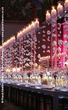 Elegant and grand table setting with candles up high - weddings and special event decor.