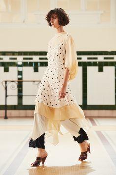 29. Soft dress in silk crepe, caraco in silk crepe print, foulard skirt in soft cotton poplin, elasticated pants in viscose satin, sandals in plastic