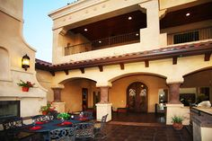 Pueblo style with open terrace for outdoor living.