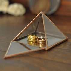 Image of Glass Pyramid Display Box, small  The pyramid is hinged, so it can be displayed open or closed. You have the choice of two hinged styles: either one triangle hinged or the entire pyramid hinged; and two finishes: silver or copper.