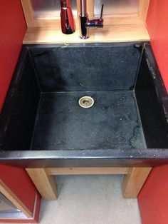 Laundry room soapstone sink.