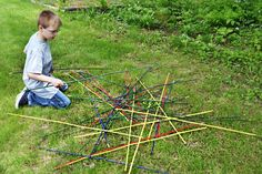 re purpose bamboo plant stakes as giant yard pick-up sticks
