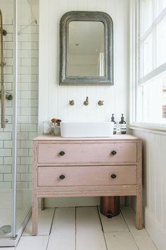 antique pink farmhouse vanity diy bathroom 16 Stylish Bathroom Vanities You Won't Believe You Can DIY Dresser Vanity Bathroom, Cheap Bathroom Vanities, Bathroom Vanity Cabinets, Cheap Bathrooms, Bathroom Pink, Country Bathrooms, Lowes Bathroom, Diy Bathroom Furniture, Master Bathroom