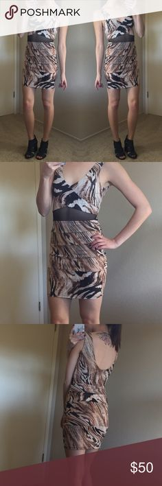 "🆑 NWOT Animal Print Dress w/ Mesh Insert This dress is absolutely perfect for a night out! Never worn but has been hanging in my closet for about 2 years. Lightweight, has a lot of stretch to it. Dress has a glittery sheen to it. Mesh insert is on the front only. Measurements laying flat: 33"" length 12"" waist 15"" hip. 95% polyester 5% spandex. Arden B Dresses"