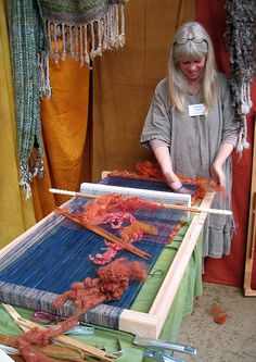 "Jane Meredith at a (homemade?) Brinkley loom, frame type __ per ""flyhoof"", it is ""another simple-but-effective kind of loom. The main element of this loom is the ingenious heddle, which is turned over after each row of weaving to raise and lower each set of warp threads so that the weft threads can pass between them."""