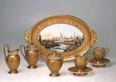 "A tête-à-tête coffee set with the monogram ""Н I"" (Nikolai the First) under the imperial crown, 1826.   A tray picturing a view of the Kremlinis not part of the set - it was made earlier in 1818.  State Hermitage Museum, Russia"
