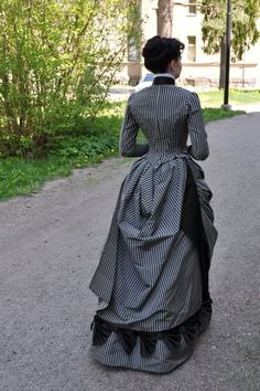 Before the automobile: 1880's Victorian gown. This woman's costume's are amazing!