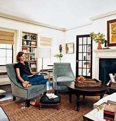 Cozy living room with lots of texture from velvet tub chairs and jute accents. From Cottage Living.