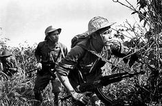 North Vietnamese soldiers recon an ARVN base at Gio Linh, Quang Tri province, 1970. ~ Vietnam War
