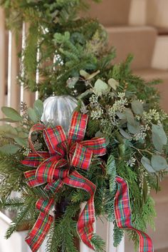 Mix seeded eucalyptus with other evergreens to trim a newel post. Tartan Christmas, Southern Christmas, Woodland Christmas, Christmas Holidays, Holidays 2017, Christmas Colors, Xmas, Christmas Garland On Stairs, Christmas Wreaths