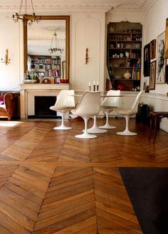 A beautiful Parisian apartment with wonderfully old herringbone floors and lots of leather furniture