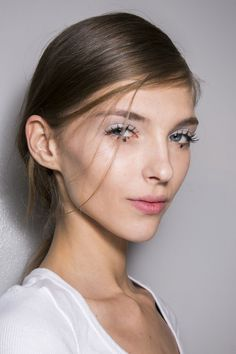The Rochas show was all about those Twiggy-inspired fat lashes with mascara pinched together for a doe eyed look. The hair was flat to the head with a deep side parting leading into a low ponytail.   - Cosmopolitan.co.uk