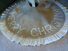 vintage button tree skirt - I would probably do multicolored buttons or white buttons on a colored/printed burlap