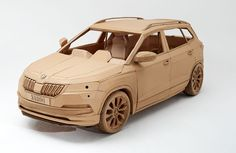 """The Czech car manufacturer ŠKODA has created the """"most friendly SUV in the world"""" made entirely of cardboard. The creation of Skoda Karoq is based on the British studio LAZERIAN Diy Cardboard Furniture, Cardboard Car, Cardboard Sculpture, Cardboard Crafts, Cardboard Design, Uses Of Paper, Wooden Toy Trucks, Paper Car, Clay Design"""