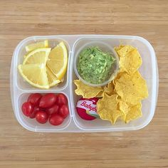 It's guacamole FriYay! Homemade guacamole made with avocados, salt, pepper, and a squeeze of lemon juice, served alongside organic scoop tortilla chips, @babybelus whole milk cheese, grape tomatoes, and orange segments (that look just like lemons 🍋, and the girlies plan on tricking their friends when eating them 😝). #lunch #lunchbox #glutenfreelunchbox #vegetarian #meatless #eattherainbow #kidsloverealfood #realfoodrocks #danasdoseofwellness #danashafirwellness #easylunchboxes…