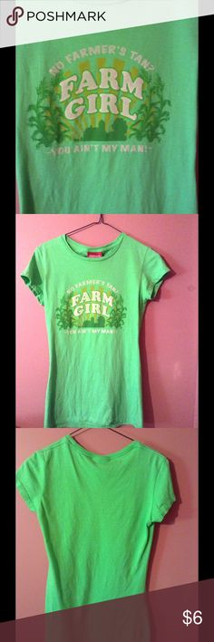 """Farm Girl tee shirt Farm Girl tee shirt. Light green. Marked size medium, more like a small. Logo reads:  Farm in middle of chest. Outside in a sort of circle """" No FARMER'S TAN? YOU AIN'T MY MAN"""". Brand:  Farm Girl. 100% cotton. Gently used   Measurements   Length:  26 inches long  Bust:  15,inches side to side   Waist:  14 inches side to side   Listing:  138 Farm Girl Tops Tees - Short Sleeve"""