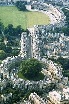 "Royal Crescent & the Circus - Bath.  ""Bath is one of my favourite places in England. It still feels just like stepping into a Jane Austen novel"" I want to go!"