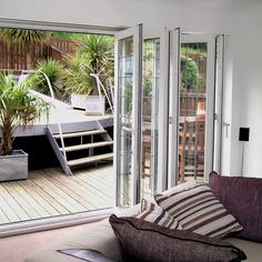 Bi-Fold door creating a sense of space and light in this living room Windows, Patio, Doors, Living Room, Space, Insulation, Furniture, Home Decor, Floor Space