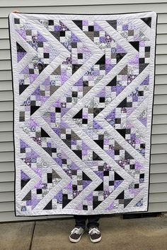 Love the subtle colors of the light purple, black, and grey.  Could put the blocks together in different ways.