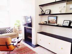 How to decorate a nook: Ikea hack, floating shelves, mid century modern, floating credenza, floating cabinets, fireplace alcove. Living room storage idea. Hide the cables and pvr box