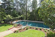 Mature trees and landscaped gardens provide a private pool-side escape.