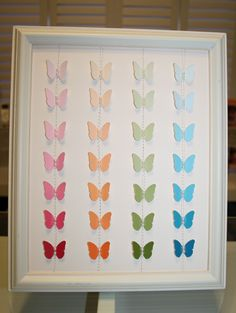 Punched out butterflies in frame from color chips