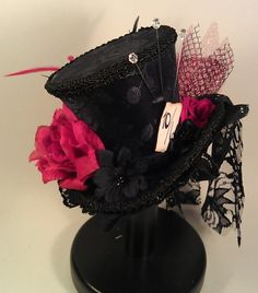Mad Hatter Mini Top Hats Made to your desire Alice in Wonderland Tea Party Burlesque. $45.00, via Etsy.
