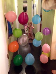 Great birthday idea for little ones! DIY - start with a long strand of ribbon, preferably the height from the floor to the ceiling. Tie several balloons to the ribbon, spread out to fit the length of the ribbon. Then attach one end of the ribbon to the ceiling with a thumb tac (or whatever you wish). So fun to watch the kids wake up & walk through the balloons on their birthday morning!