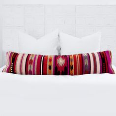 Baya Lumbar Pillow Handwoven in Mexico by The Women of Oaxaca Inspired by the geometric patterns used by the Zapotec tribes of the Oaxaca region, this lumbar pillow's structural