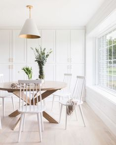 Soft white and wood dining nook