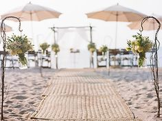 A beautiful beach ceremony set-up by Pryor Events, Los Angeles.