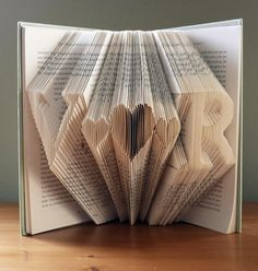 Wedding Decorations - Unique - Monogrammed Folded Book -  Initials With 3 Hearts In Between - Wedding Present -  Paper Anniversary. $60.00, via Etsy.