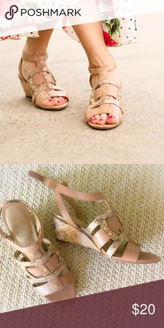 Nude gladiator cork wedge sandals Worn 1x. Faux leather upper in a dress style with an open toe Ankle strap with hook-and-loop closure Gladiator-inspired strap design with snakeskin texture and metallic stud details N5 Comfort technology, featuring a flexible sole, lightweight materials, extra cushioning, heel-to-toe balance, and a breathable lining Non-slip outsole for stability, 2 1/2 inch cork-wrapped wedge heel. Naturalizer Shoes Wedges