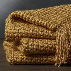 A textural weave of chunky acrylic and chenille yarns craft a warm, heavy weight throw that's great to snuggle under. Accented with five-inch fringe, it drapes a golden layer over a sofa or armchair.