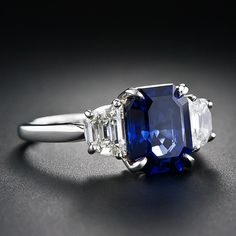 3.90 Carat Sapphire and Diamond Ring emerald cut sapphire, trapeze cut diamonds