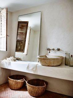 gorgeous freestanding vanity, bowl sink, learning mirror, shuttered windows, and baskets under vanity. also love the herringbone floor tiles!
