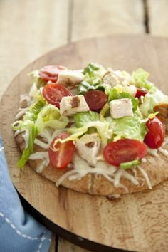 Chicken Caesar Pita Pizza. With low fat ceasar dressing and a whole wheat pita, would be a healthy lunch.