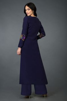Talking Threads Signature suits are crafted in fine fabrics and adorned with exquisite embroideries. This Eclipse Blue long tunic k Embroidery On Kurtis, Kurti Embroidery Design, Embroidery Fashion, Wide Leg Palazzo Pants, Indian Designer Suits, Dress Neck Designs, Pakistani Suits, Embroidered Tunic, Couture Collection