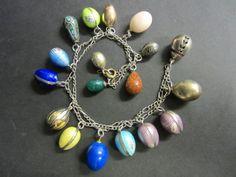 Various antique Russian gold, enamel, jeweled and hardstone miniature egg pendants, circa 1900 - 1910