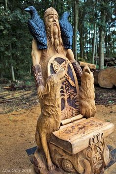 Beautiful carved Odin with wolves and ravens
