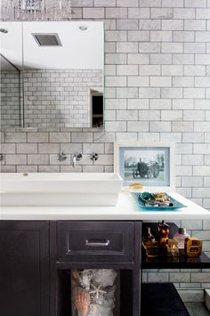 Bathroom - A dark wood custom vanity with open shelving and an elongated trough sink against subway tile