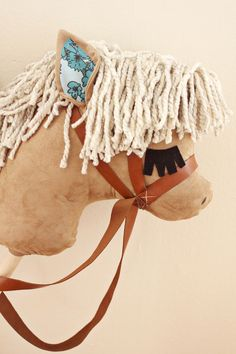 Gift Idea: DIY Stick Horses - A Beautiful Mess - I love the eyes so cute!