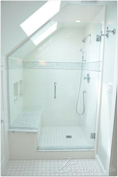 big shower with bench seat and sky light